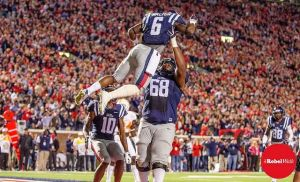 One of Jaylen Walton's touchdowns against Tennessee in 2014 is celebrated with a lift in the air from Justin Bell. (Photo credit: Bentley Breland, The Rebel Walk)