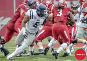 Nkemdiche with eyes set on Razorback RB Collins in the 2014 Arkansas game. (Photo credit: Bentley Breland, The Rebel Walk)
