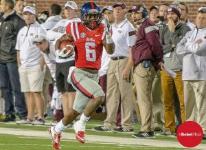 Jaylen Walton races for a 91-yard touchdown run against the Bulldogs in the 2014 Ole Miss Egg Bowl  win over State. (Photo credit: Bentley Breland, The Rebel Walk)