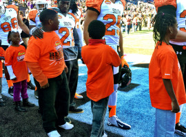 Prewitt and Golson with local kids before game