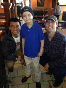 Chance frequently enjoyed time with Rebel players Evan Engram (L) and Ryan Buchanan (R). The two would later be pall bearers at Chance's funeral. (Photo courtesy of the Tetrick Family.)