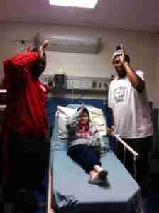 Rebel Def. tackle Herbert Moore (left) and NEMCC LB Marcus Robinson (right) visit Chance in the hospital. (Photo courtesy of The Tetrick Family.)