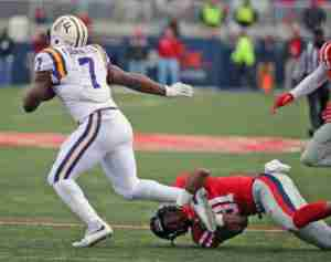 DeMarquis Gates tackles Leonard Fournette in the Rebels' 38-17 win. (Photo credit; Joshua McCoy, Ole Miss Athletics)