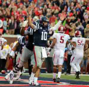Chad Kelly scored three TDs rushing and threw for 3 more. (Photo credit: Joshua McCoy, Ole Miss Athletics)