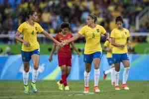 Soccer: 2016 Summer Olympics: Brazil Rafaelle (4) victorious with Monica (3) vs China during Women's Group Stage - Group E match at Olympic Stadium. Rio de Janeiro, Brazil 8/3/2016 (Photo credit: Donald Miralle)
