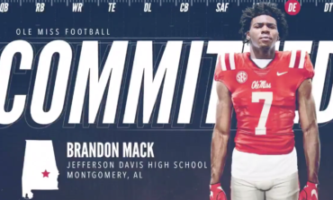 Defensive end Brandon Mack signs with the Rebels