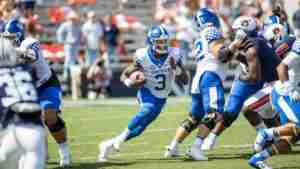 Terry Wilson runs with the ball.